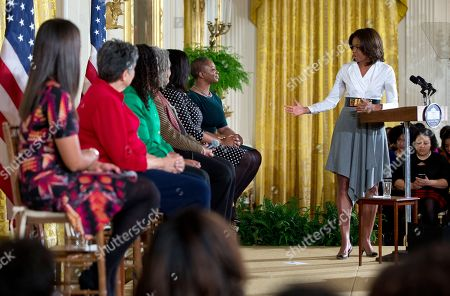 "Michelle Obama, Sherrilyn Ifill, Janaye Ingram, Chanelle Hardy, Vanessa DeLuca, Charlayne Hunter-Gault, Carlotta Walls First lady Michelle Obama speaks in the East Room of the White House in Washington, during the ""Celebrating Women of the Movement,"" event honoring Black History Month. On stage with the first lady from left, Janaye Ingram, National Executive Director of the National Action Network, Carlotta Walls, member of the Little Rock Nine, Sherrilyn Ifill, President and Director-Counsel of the NAACP Legal Defense and Educational Fund, Charlayne Hunter-Gault, activist and journalist, Chanelle Hardy, National Urban League Senior Vice President, and Vanessa DeLuca, Editor-in-chief of Essence Magazine"