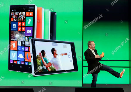 Stephen Elop Stepen Elop, executive vice president of Nokia shows off his colored shoe while talking about the colors available of the new Nokia Lumia 930 phones during a keynote address at the Microsoft Build Conference, in San Francisco. Microsoft kicked off its annual conference for software developers, with new updates to the Windows 8 operating system and upcoming features for Windows Phone and Xbox