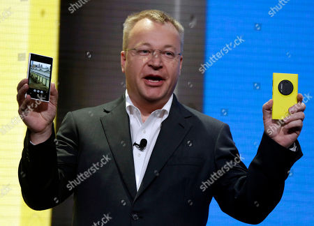 Nokia Lumia 1020, Stephen Elop Then Nokia CEO Stephen Elop shows the company's Nokia Lumia 1020, in New York. Elop, now Microsoft Executive Vice President, sent employees of the company's devices business a memo detailing its job cut plans. Microsoft on said it would cut up to 18,000 jobs over the next year, with about 12,500 related to Microsoft's acquisition of Nokia's phone business in April