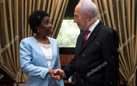 United Nations Deputy Secretary-General Asha Rose Migiro, left, shakes hands with Israel's President Shimon Peres in his Jerusalem office