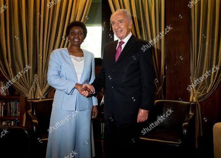 Asha Rose Migiro, Shimon Peres United Nations Deputy Secretary-General Asha Rose Migiro, left, shakes hands with Israel's President Shimon Peres in his Jerusalem office