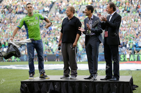 Clint Dempsey, Joe Roth, Adrian Hanauer, Peter McLoughlin Clint Dempsey, left, captain of the United States Mens National Soccer Team, takes off his sweatshirt to reveal a Seattle Sounders Jersey as he is introduced by Sounders owner Joe Roth, second from left, Sounders general manager Adrian Hanauer, second from right, and Sounders president Peter McLoughlin, right, during a ceremony, prior to a match between the Sounders and FC Dallas in Seattle. Dempsey previously played for Tottenham Hotspur in the English Premier League