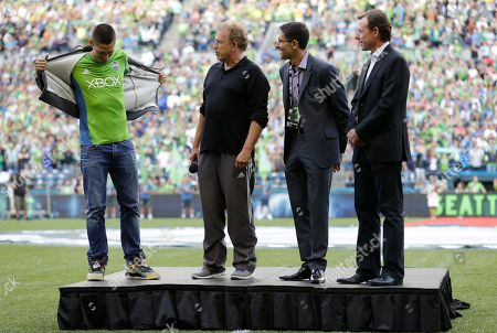 Clint Dempsey, Joe Roth, Adrian Hanauer, Peter McLoughlin Clint Dempsey, left, captain of the United States Mens National Soccer Team, takes off his sweatshirt to reveal a Sounders jersey as he stands with Sounders owner Joe Roth, second from left, Sounders general manager Adrian Hanauer, second from right, and Sounders president Peter McLoughlin, right, during a ceremony introducing Dempsey as the newest member of the Sounders, prior to a match between the Sounders and FC Dallas in Seattle. Dempsey previously played for Tottenham Hotspur in the English Premier League