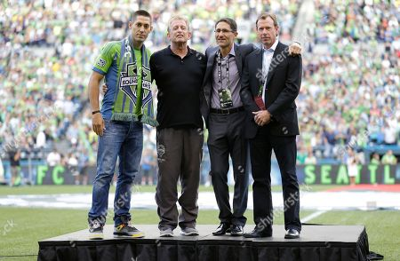 Clint Dempsey, Joe Roth, Adrian Hanauer, Peter McLoughlin Clint Dempsey, left, captain of the United States Mens National Soccer Team, poses for a photo with Sounders owner Joe Roth, second from left, Sounders general manager Adrian Hanauer, second from right, and Sounders president Peter McLoughlin, right, during a ceremony introducing Dempsey as the newest member of the Sounders, prior to a match between the Sounders and FC Dallas in Seattle. Dempsey previously played for Tottenham Hotspur in the English Premier League