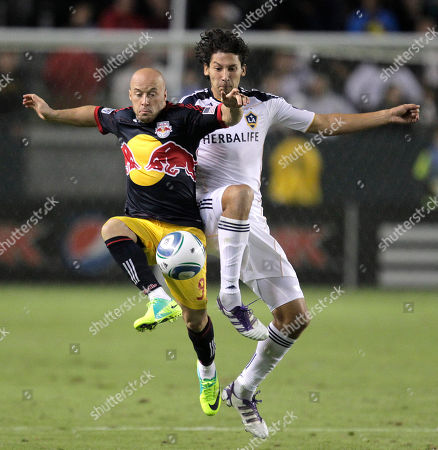Luke Rodgers, Omar Gonzalez New York Red Bulls forward Luke Rodgers, left, and Los Angeles Galaxy defender Omar Gonzalez fight for the ball during the second half of the second game of an MLS soccer Western Conference semifinal at Home Depot Center in Carson, Calif., . The Galaxy won 2-1