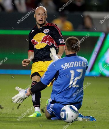 Stock Image of Luke Rodgers, Josh Saunders New York Red Bulls forward Luke Rodgers, left, scores against Los Angeles Galaxy goalkeeper Josh Saunders during the first half of the second game of an MLS soccer Western Conference semifinal, in Carson, Calif