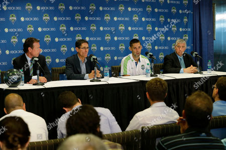 Clint Dempsey, Sigi Schmid, Adrian Hanauer, Peter McLoughlin Clint Dempsey, second from right, talks with reporters along with Seattle Sounders head coach Sigi Schmid, right, Sounders president Peter McLoughlin, left, and Sounders general manager Adrian Hanauer, second from left, after Dempsey was introduced as the newest player for the Seattle Sounders MLS soccer team, in Seattle. Dempsey previously played for Tottenham Hotspur in the English Premier League