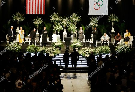 Muhammad Ali's wife Lonnie Ali walks up to the podium to speak during his memorial service, in Louisville, Ky