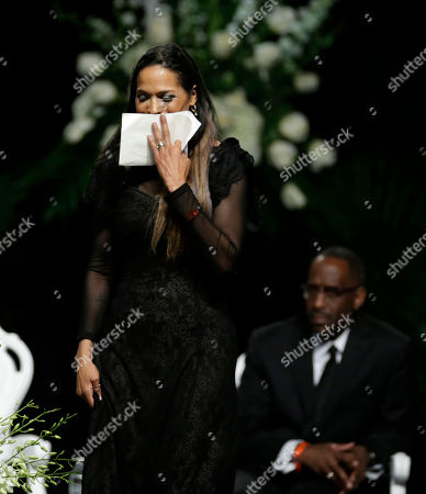 Muhammad Ali's daughter Rasheda Ali-Walsh walks off the stage after speaking during his memorial service, in Louisville, Ky