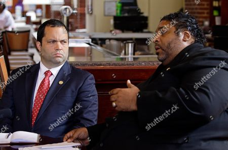 Benjamin Jealous, William Barber Benjamin Jealous, president of the national NAACP, left, listens to the Rev. William Barber during an interview in Raleigh, N.C., . Jealous is asking investigators to find the person responsible for a death threat he says were made against Barber, who is the leader of the organization's North Carolina chapter