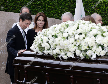 Stock Image of Patti Davis, right, and Ronald Prescott Reagan, left, pause at the casket during graveside service for Nancy Reagan at the Ronald Reagan Presidential Library, in Simi Valley, Calif