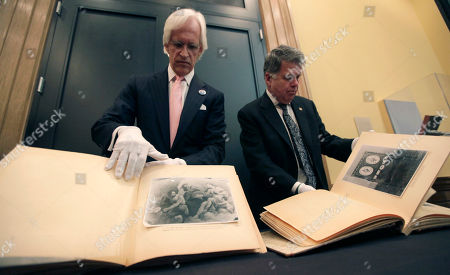 David S. Ferriero, Robert M. Edsel David S. Ferriero, archivist of the United States, right, and Robert M. Edsel, founder and president of Monuments Men Foundation for the Preservation of Art show two newly discovered albums containing photographs of art works and furniture stolen by the Nazis during World War II after they were unveiled at a news conference in the Meadows Museum at SMU in Dallas, . The Dallas-based Monuments Men Foundation for the Preservation of Art had been contacted by relatives of two World War II soldiers who took the albums from Hitler's home. They'll be donated to the U.S. National Archives