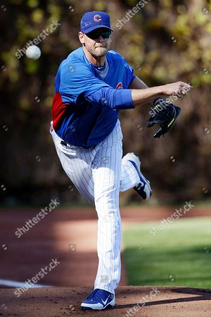 Kerry Wood Chicago Cubs pitcher Kerry Wood throws during a workout at Wrigley Field in Chicago, . The Cubs open their season Thursday against the Washington Nationals