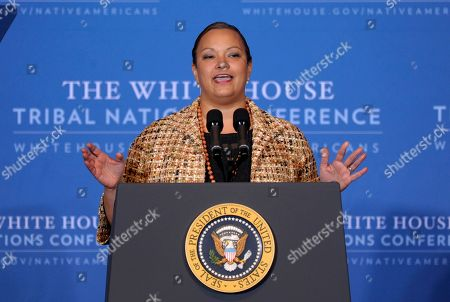 """Lisa Jackson EPA Administrator Lisa Jackson speaks at the 2012 Tribal Nations Conference, at the Interior Department in Washington. Native American tribal leaders are concerned that steady progress on their issues might be undermined if President Barack Obama and Congress make deep spending cuts to avoid the """"fiscal cliff."""" More than 500 tribal leaders were taking those concerns to the fourth White House Tribal Nations summit, which convenes Wednesday"""