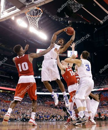 Duke's Justise Winslow grabs a rebound against Wisconsin's Nigel Hayes (10) and Sam Dekker (15) during the second half of the NCAA Final Four college basketball tournament championship game, in Indianapolis