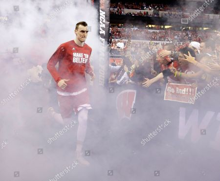Wisconsin's Sam Dekker runs to the court before the NCAA Final Four college basketball tournament championship game against Duke, in Indianapolis