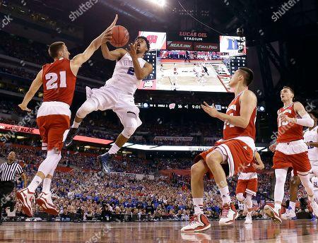 Duke's Quinn Cook (2) goes up for a shot against Wisconsin's Josh Gasser (21) during the first half of the NCAA Final Four college basketball tournament championship game, in Indianapolis