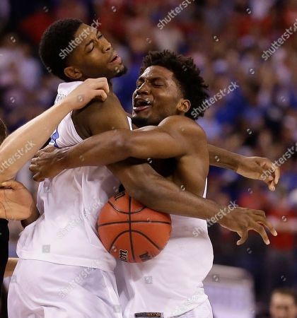 Duke's Amile Jefferson, left, and Justise Winslow celebrate after their team's 68-63 victory over Wisconsin in the NCAA Final Four college basketball tournament championship game, in Indianapolis