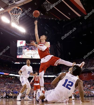 Wisconsin's Sam Dekker shoots over Duke's Justise Winslow (12) during the second half of the NCAA Final Four college basketball tournament championship game, in Indianapolis