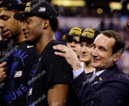 Duke head coach Mike Krzyzewski, right, celebrates with Justise Winslow after their 68-63 victory over Wisconsin in the NCAA Final Four college basketball tournament championship game, in Indianapolis