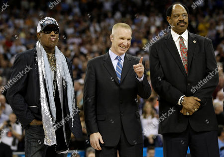 Stock Image of Basketball Hall of Famers Dennis Rodman, Chris Mullin and Artis Gilmore are introduced at halftime of the men's NCAA Final Four college basketball championship game between Butler and Connecticut, in Houston