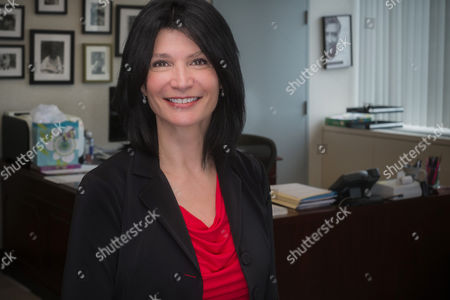 """Lily Eskelsen Garcia Shows National Education Association (NEA) President Lily Eskelsen Garcia posing for a portrait in her office before an interview with The Associated Press at the association's headquarters in Washington. Garcia is a Spanish speaking, guitar playing author and a former Utah teacher of the year who doesn't shy from criticizing what she describes as """"toxic"""" testing"""