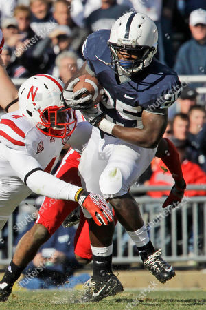 Silas Redd, Lavonte David Penn State running back Silas Redd (25) is tackled by Nebraska's Lavonte David (4) during the first quarter of an NCAA college football game in State College, Pa