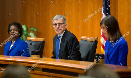 """Tom Wheeler, Jessica Rosenworcel, Jessica Rosenworcel Federal Communication Commission (FCC) Chairman Tom Wheeler, center, with FCC Commissioners Mignon Clyburn, left, and Jessica Rosenworcel, before the start of their open hearing in Washington, . Internet service providers like Comcast, Verizon, AT&T, Sprint and T-Mobile would have to act in the """"public interest"""" when providing a mobile connection to your home or phone, under new rules being considered by the Federal Communications Commission. The rules would put the Internet in the same regulatory camp as the telephone, banning providers from """"unjust or unreasonable"""" business practices"""