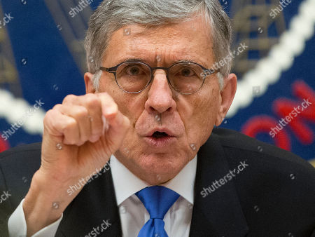 """Tom Wheeler Federal Communications Commission (FCC) Chairman Tom Wheeler gestures near the end of a hearing for a vote on Net Neutrality, at the FCC in Washington. The FCC has agreed to impose strict new regulations on Internet service providers like Comcast, Verizon and AT&T. The regulatory agency voted 3-2 Thursday in favor of rules aimed at enforcing what's called """"net neutrality."""" That's the idea that service providers shouldn't intentionally block or slow web traffic, creating paid fast lanes on the Internet"""