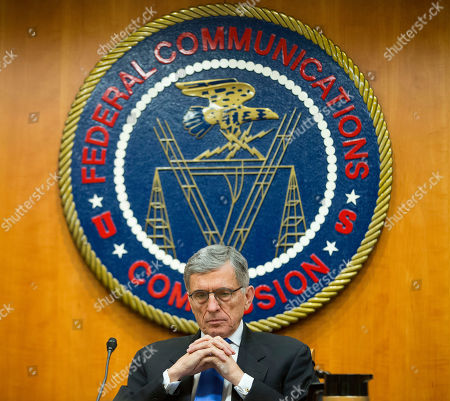 """Tom Wheeler Federal Communication Commission (FCC) Chairman Tom Wheeler pauses during an open hearing and vote on Net Neutrality in Washington, . The FCC has agreed to impose strict new regulations on Internet service providers like Comcast, Verizon and AT&T. The regulatory agency voted 3-2 Thursday in favor of rules aimed at enforcing what's called """"net neutrality."""" That's the idea that service providers shouldn't intentionally block or slow web traffic, creating paid fast lanes on the Internet"""