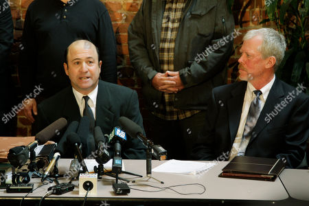 Attorneys David Mann, right, and Peter Goldman, left, talk to reporters, about their intent to file a lawsuit on behalf of International Longshore and Warehouse Union Local 19, opposing plans to build a new sports arena in the area south of downtown Seattle, near the Mariners and Seahawks stadiums. The union says another sports venue in the Sodo area will erode maritime and warehousing businesses and threaten the livelihood of union members and other workers