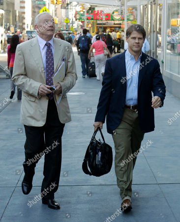 Stock Photo of Robert Craft Dallas Cowboys owner Jerry Jones, left, and Kansas City Chiefs owner Clark Hunt arrives at a Manhattan law firm in New York. With time running short to keep the NFL's preseason completely intact, owners and player representatives are back in force, trying again to work out a new labor deal