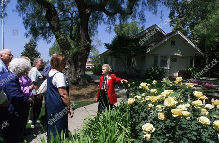 BETTS NIXON BIRTHPLACE Hazel Betts, a docent volunteer leads a garden tour at The Nixon Library & Birthplace in Yorba Linda, Calif. On the background, President Nixon's birthplace home. The daughters of former President Richard Nixon have always pulled together in the darkest of times, from the Watergate investigation to their father's 1974 resignation. But a legal fight over a $19 million gift to the Richard Nixon Library and Birthplace Foundation, has set the two daughters against each other and brought into question the stewardship of the library. Published reports have painted the issue as a feud, saying Julie Nixon Eisenhower and Tricia Nixon Cox have cut off communication. But in interviews with The Associated Press, the two women denied that and characterized the dispute as a disagreement they are working to resolve