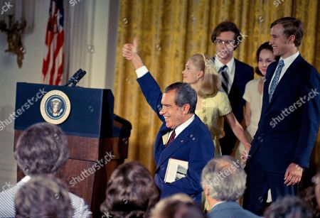 Richard Nixon, Julie Nixon Eisenhower, David Eisenhower, Edward F. Cox President Richard M. Nixon gives a thumb's up as he and his family leave the podium following his farewell speech to his staff, . From left: the president, his daughter Tricia Nixon Cox, son-in-law David Eisenhower, daughter Julie Nixon Eisenhower and son-in-law Edward Cox