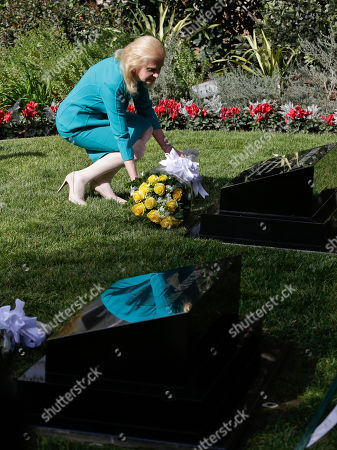 Tricia Nixon Cox daughter of the 37th U.S. President Richard M. Nixon lays flower on her mother Pat's head stone during a ceremony honoring the 100th anniversary of the birth of Richard Nixon at the Richard Nixon Presidential Library in Yorba Linda, Calif