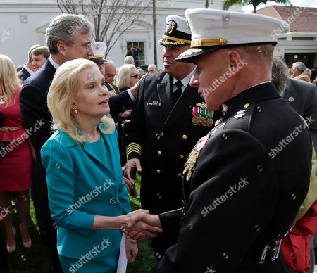 Tricia Nixon Cox, left, daughter of the 37th U.S. President Richard M. Nixon greets U.S. Marine Corps Major General Melvin Spiese after a commemoration of the 100th anniversary of the birth of Richard Nixon at the Richard Nixon Presidential Library in Yorba Linda, Calif