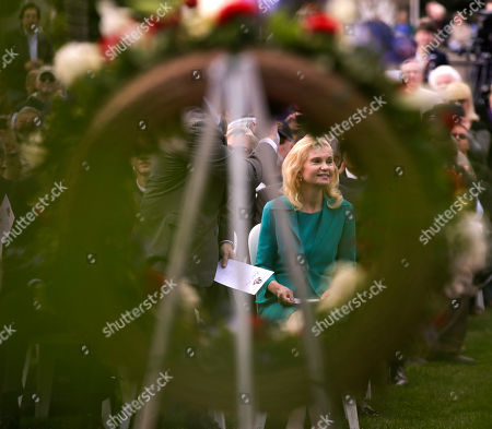 Tricia Nixon Cox daughter of the 37th U.S. President Richard M. Nixon is framed in a wreath honoring her father during a commemoration of the 100th anniversary of the birth of Richard Nixon at the Richard Nixon Presidential Library in Yorba Linda, Calif