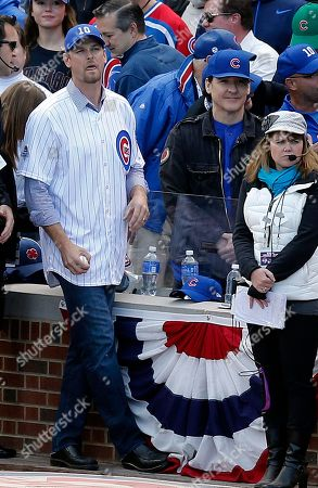 Kerry Wood, John Cusack Former MLB baseball player Kerry Wood talks to actor John Cusack before Game 4 in baseball's National League Division Series between the Chicago Cubs and the St. Louis Cardinals, in Chicago