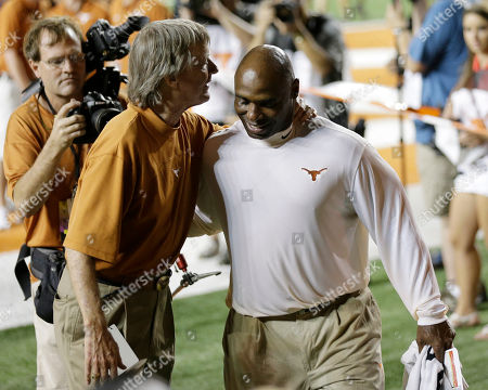 Bill Powers, Charlie Strong Texas President Bill Powers congratulates Texas coach Charlie Strong after his fist win following an NCAA college football game against North Texas, in Austin, Texas. Texas won 38-7