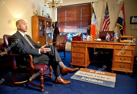 Bronx Borough President Ruben Diaz, Jr., speaks during an interview about his proposal to create a letter grading system for cosmetology businesses, in New York. Dirty nail clippers could get the same treatment as spoiled food under a proposal to expand New York City's restaurant letter-grade system to a new frontier: barbershops, hair salons and nail salons