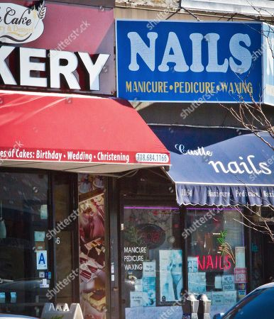 """A bakery with a food grade rating of """"A"""" is next to Castle nail salon, in New York. Bronx Borough President Ruben Diaz, Jr., has proposed legislation that would create a similar letter grading system for cosmetology businesses, including nail salons, spas, barber shops and beauty parlors in New York City"""