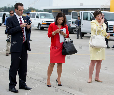 Barack Obama, David Plouffe, Valerie Jarrett, Nancy-Ann DeParle Senior White House Advisor David Plouffe, left, Assistant to the President and Deputy Chief of Staff Nancy-Ann DeParle, center, and Senior White House Advisor Valerie Jarrett, work on the tarmac as President Obama arrives at Cincinnati Northern Kentucky International Airport, in Hebron, Ky