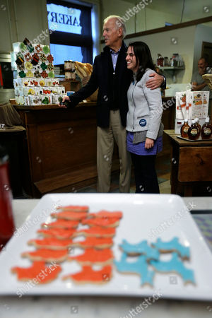 Joe Biden Vice President Joe Biden poses for a photograph with Caroline Martin during a visit to the Red Mug Bake Shop in view of blue Democratic donkey cookies and red Republican elephant cookies, in Superior, Wis