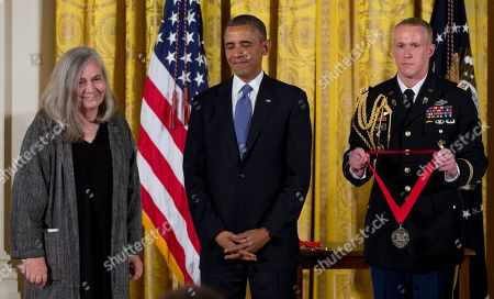Barack Obama, Marilynne Robinson President Barack Obama stands with Marilynne Robinson as he awards her the 2012 National Humanities Medal for her grace and intelligence in writing, during a ceremony in the East Room of White House, in Washington