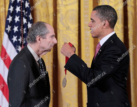 Barack Obama, Philip Roth President Barack Obama presents a 2010 National Humanities Medal to novelist Philip Roth, during a ceremony in the East Room of the White House in Washington