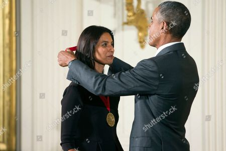 Stock Image of Barack Obama, Jhumpa Lahiri President Barack Obama awards the 2014 National Humanities Medal to author Jhumpa Lahiri of New York, during a ceremony in the East Room at the White House in Washington