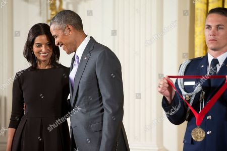 Barack Obama, Jhumpa Lahiri President Barack Obama awards the 2014 National Humanities Medal to author Jhumpa Lahiri of New York during a ceremony in the East Room at the White House in Washington