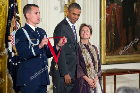 Barack Obama, Alice Waters Chef, author, and advocate Alice Waters of Berkeley, Calif., right, stands with President Barack before being presented with the National Humanities Medal in the East Room of the White House,, in Washington