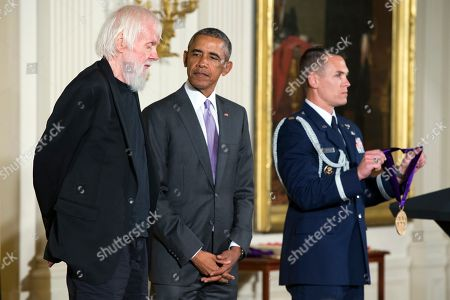 Barack Obama, John Baldessari Visual artist John Baldessari of Venice, Calif., left, stands with President Barack Obama before receiving the 2014 National Medal of Arts in the East Room of the White House,, in Washington
