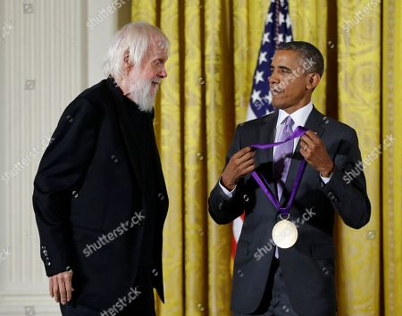 Barack Obama, John Baldessari President Barack Obama awards the 2014 National Medal of Arts to visual artist John Baldessari of Venice, Calif., during a ceremony in the East Room at the White House in Washington